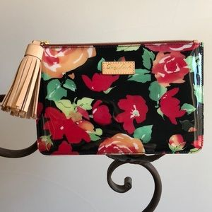 Dooney & Bourke Floral clutch with Leather Tassel.